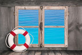 Holiday concept: lifebelt with sea view. — Stockfoto