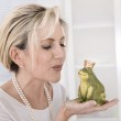Single attractive older woman with a frog king in her hands. — Stock Photo #46106139