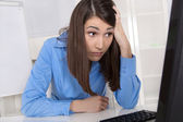 Depressed and stressed young business woman finding mistake. — Stock Photo
