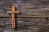 Wooden cross with jesus on a background for a obituary notice. — Stock Photo
