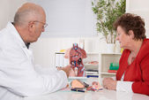 Appointment: senior patient and older male doctor. — Stock Photo