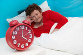 Senior woman in bed ill and suffered of sleeplessness or insomni — Stock Photo