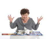 Happy female pensioner after smashing her piggy box. Money conce — Stock Photo