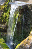 Natural waterfall in the garden. — Stock Photo