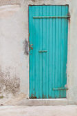 An old wooden turquoise or green door in a old house. — Stock Photo