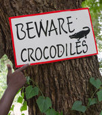 "African Sign with text ""Beware crocodiles"" — Stock Photo"