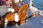 Old nostalgic sail boat - cockpit and rudder of teak wood. — Stock Photo