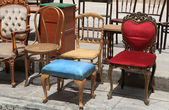 Collection of old broken chairs on the flea market. — Stock Photo