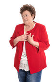 Portrait: Isolated older woman in red has heart problems. — Foto Stock