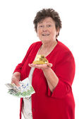 Isolated senior woman with money: concept for pension and herita — Stock Photo