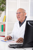 Occupation: portrait of an older male doctor — Stock Photo