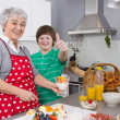 Happy family: Grandmother and grandson cooking together. — 图库照片