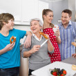 Three generation living together: happy family in the kitchen. — Stock Photo