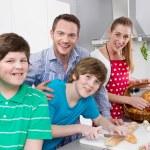 Happy family in the kitchen preparing breakfast on sunday. — Stock Photo