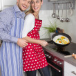 Young fresh married couple in the kitchen cooking together fried — Stock Photo #48821907