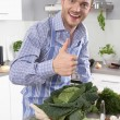 Man in the kitchen with thumb up preparing dinner. — Stock Photo #48822429