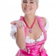 Pretty young girl in bavarian dirndl isolated give a kiss with h — Stock Photo #48822813