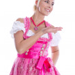 Bavarian woman - isolated in bavarian dress presenting and makin — Stock Photo #48822851