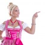 Beautiful bavarian woman isolated making promotion for Oktoberfe — Stock Photo #48822873