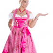 Bavarian woman - isolated in bavarian dress presenting and makin — Stock Photo #48822879