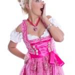 Amazed beautiful isolated bavarian woman wearing pink traditiona — Stock Photo #48822913