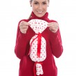 Isolated smiling young woman in red holding a present in her han — Foto de Stock