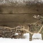 Handmade elk or reindeer with slide of wood on wooden background — Stock Photo #48825027