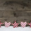 Wooden christmas background with red white checked hearts and st — Stock Photo #48825223