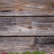 Old background of wood with red xmas balls and moss. — Stock Photo