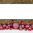 Wooden christmas background with red balls for a greeting card. — Stock Photo #48825693