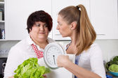 Diet course: fat woman will loosing weight with a dietitians. — Photo