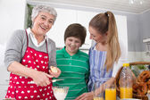 Three generations living together - happy family cooking togethe — Stock Photo