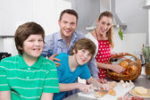 Happy family in the kitchen preparing breakfast on sunday. — Stock Photo
