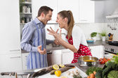Young couple screaming at home in the kitchen. — Stock Photo