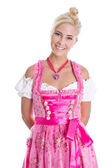 Pretty isolated young woman wearing bavarian dress called dirndl — Foto de Stock