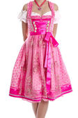 """Traditional bavarian dress called """"Dirndl"""" isolated and in pink  — Stock Photo"""