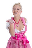 Pretty young girl in bavarian dirndl isolated give a kiss with h — Stock Photo