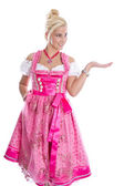 Bavarian woman - isolated in bavarian dress presenting and makin — Foto de Stock
