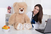 Young female doctor for children with a teddy bear. — Stock Photo