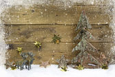 Wooden country style christmas background with reindeer and snow — Zdjęcie stockowe
