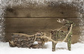 Handmade elk or reindeer with slide of wood on wooden background — ストック写真