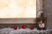 Christmas wooden background with an old rustic latern. — Stock Photo