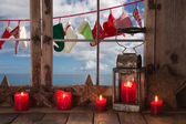 Window-sill decorated with red christmas candles: view to the oc — Stock Photo