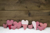 Handmade red white checked hearts on a wooden christmas backgrou — Stock Photo
