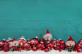 Turquoise green wooden christmas background with red balls. — Stok fotoğraf