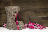 Wooden christmas background with a handmade boot of wood. — Photo