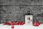 White shabby chic latern for christmas with candle and red balls — Stok fotoğraf