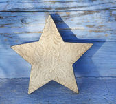 Old golden wooden christmas star for decoration. — Stock Photo