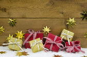 Christmas background with presents and gifts in gold and red. — Stock Photo