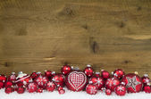 Christmas background of wood decorated with red balls and snow. — Stock Photo